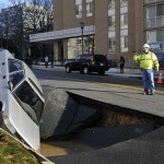 Fortunately, most sinkholes in California are man-made phenomena. A water main break causes a sinkhole that partially swallows a parked car. Photo © 2010 Jay Mallin
