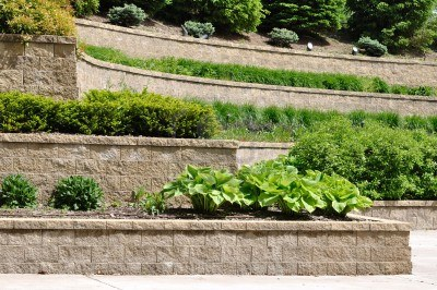 Multiple tiered retaining walls
